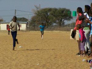 Kids finishing a race.